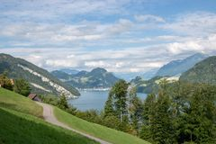 Panorama view of Lucerne lake and mountains scene in Pilatus of Lucerne. Switzerland, Europe. Summer landscape, sunshine weather, dramatic blue sky and sunny stock photo