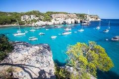 Boats and yachts on Macarella beach, Menorca, Spain Stock Photos