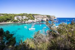 Boats and yachts on Macarella beach, Menorca, Spain. Panorama view of Macarella beach in Menorca, Balearic Islands, Spain Stock Photo