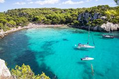 Boats and yachts on Macarella beach, Menorca, Spain. Panorama view of Macarella beach in Menorca, Balearic Islands, Spain Royalty Free Stock Photo