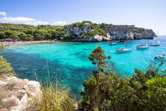 Boats and yachts on Macarella beach, Menorca, Spain. Panorama view of Macarella beach in Menorca, Balearic Islands, Spain Stock Images