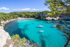 Boats and yachts on Macarella beach, Menorca, Spain. Panorama view of Macarella beach in Menorca, Balearic Islands, Spain Royalty Free Stock Photos