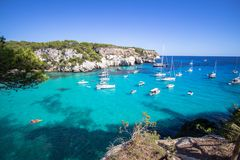 Boats and yachts on Macarella beach, Menorca, Spain. Panorama view of Macarella beach in Menorca, Balearic Islands, Spain Stock Photography