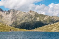 Panorama view of Marjelen lakes, scene in mountains. Route great Aletsch Glacier in national park Switzerland, Europe. Summer landscape, sunshine weather, blue stock image