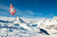 Panorama view of Matterhorn and swiss flag. View on Matterhorn, swiss flag and Riffelberg ski station Stock Photography