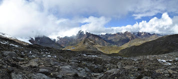 Mountain pass panorama, Huapi, Peru. Panorama shot after climbing up the Huapi pass during the Quillcayhuanca trek stock photos