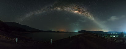 Panorama view of milky way galaxy over the dam Royalty Free Stock Images