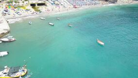 Panorama view of Monterosso al Mare village one of Cinque Terre in La Spezia, Italy. Drone moves away from the coast and people