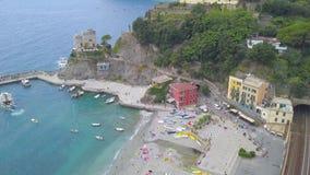 Panorama view of Monterosso al Mare village one of Cinque Terre in La Spezia, Italy. The view opens onto the peninsula, beach, sea
