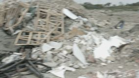 Panorama view of neglected landfill site. Tones of waste contaminating nature. Stock footage stock video footage