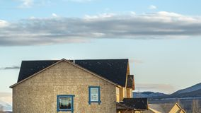 Panorama View of new houses under construction under stunning blue sky with clouds. A mountain can also be seen in the distance on this breautiful sunny day royalty free stock photos