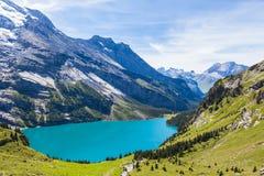 Panorama view of Oeschinensee (Oeschinen lake) on bernese oberla Stock Images