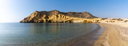 Free Panorama View Of A Secluded Cove And Beach On The Meiterranean Coast Of Spain With Caves And Sandstone Cliffs Behind Stock Images - 211259254