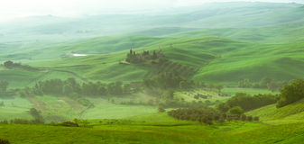 Panorama. View of the Orcia river valley. Early morning, sunrise, fog Royalty Free Stock Photos