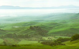 Panorama. View of the Orcia river valley. Early morning, sunrise, fog Royalty Free Stock Photo