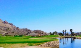 Panorama view over beautiful Golf hole stock photography