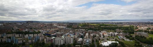 Panorama view over Edinburgh. From Holyrood Park a royal park in Scotland Royalty Free Stock Photography