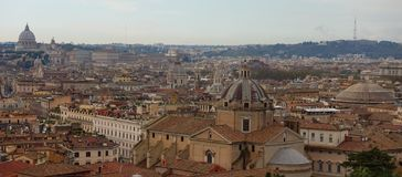 Panorama view over Rome, Saint Peter`s Dome at background royalty free stock photography