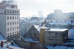 Panorama view over Zagreb with smoking chimneys during winter with snow over the roofs, Zagreb, Croatia, Europe. Panorama view over Zagreb with smoking chimneys Royalty Free Stock Images