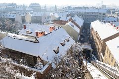 Panorama view over Zagreb with tramrails during winter with snow over the roofs, Zagreb, Croatia, Europe. Panorama view over Zagreb with tramrails during winter Stock Photo