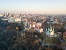 Panorama view of Podol and beautiful baroque St. Andrew`s Church in Kiev city, Ukraine royalty free stock image