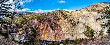 Panorama view of the Railway through the Fraser Canyon Route following the Thompson River in British Columbia, Canada. Panorama view of the Railway through the Royalty Free Stock Images