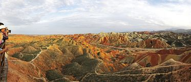 Panorama View of Rainbow Mountains Geological Park. Stripy Zhangye Danxia Landform. Geological Park in Gansu Province, China. Road in a Valley on a Sunny Day stock image