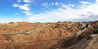 Panorama View of Rainbow Mountains Geological Park. Stripy Zhangye Danxia Landform. Geological Park in Gansu Province, China. Valley on a Sunny Day royalty free stock image
