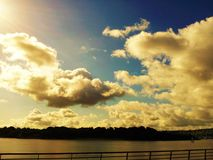 Panorama. View of the river and beautiful clouds Stock Image