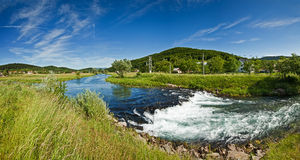 Panorama view of River Gacka near Otočac, Croatia. Panorama view of the flow of River Gacka near Otočac, Croatia - a place where the original flow of the stock images