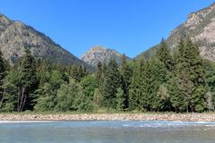 Panorama view of river scene in mountains of national park Dombay, Caucasus. Russia, Europe. , Dramatic blue sky and sunny summer landscape stock image