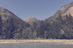 Panorama view of river scene in mountains of national park Dombay, Caucasus. Russia, Europe. , Dramatic blue sky and sunny summer landscape royalty free stock image