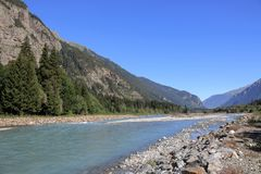 Panorama view of river scene in mountains of national park Dombay, Caucasus. Russia, Europe. , Dramatic blue sky and sunny summer landscape royalty free stock images