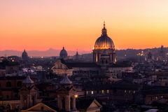 Panorama view of Rome at sunset with St Peter Cathedral Royalty Free Stock Photo
