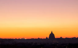 Panorama view of Rome at sunset with St Peter Cathedral Stock Images