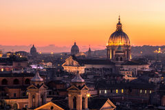 Panorama view of Rome at sunset with St Peter Cathedral Stock Photo