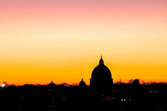 Panorama view of Rome at sunset with St Peter Cathedral Royalty Free Stock Images