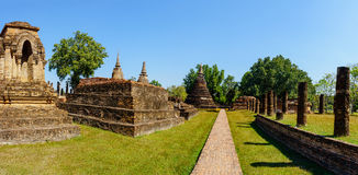 Panorama view of the ruins of Wat Mahathat in Sukhothai Historical park Royalty Free Stock Photography