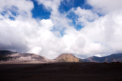 Panorama view at the sandy foot of the active Volcano mount Bromo early in the morning at the Tengger Semeru National Park. Royalty Free Stock Image