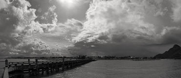 Panorama view of sea bridge and dark rainny cloud coming,prachuapkhirikhan,thailand, black and white picture style. Panorama view of sea bridge and dark rainny royalty free stock image
