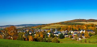 Panorama view Seiffen in Autumn . Saxony Germany ore mountains with blue sky.  royalty free stock photo
