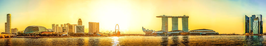 Panorama view of Singapore skyline with urban buildings in sunse. T Stock Images