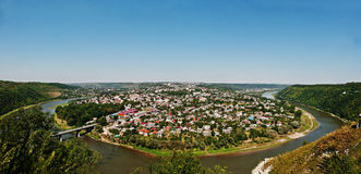 Panorama view of small city round peninsula with river and bridg Stock Photography