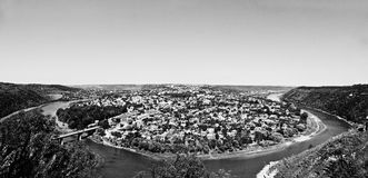 Panorama view of small city round peninsula with river and bridg Stock Photos