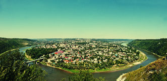 Panorama view of small city round peninsula with river and bridg Stock Image