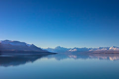 Panorama view of snow, mountain layer, ice and lake with reflect. Traveling in New Zealand stock photo