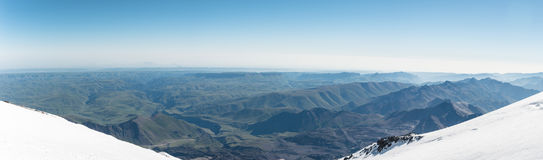 Panorama View of the summer northern caucasus from the snow-capped summit of Elbrus Royalty Free Stock Photo