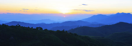 Panorama view of sun rising over mountain scene use for natural Royalty Free Stock Image