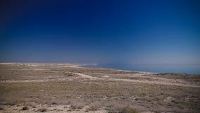 Panorama view to Aral sea from the rim of Plateau Ustyurt near Aktumsuk cape , Karakalpakstan, Uzbekistan. Panorama view to Aral sea from the rim of Plateau Royalty Free Stock Photo