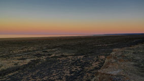 Panorama view to Aral sea from the rim of Plateau Ustyurt near Aktumsuk cape at sunset, Karakalpakstan, Uzbekistan. Panorama view to Aral sea from the rim of Stock Image
